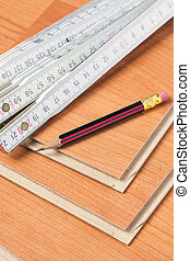 laminate floor with wooden ruler  and pencil