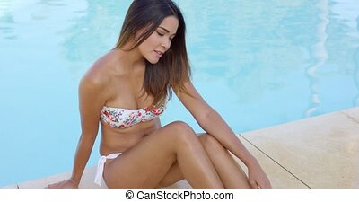 Beautiful single woman in bikini at edge pool - Single...