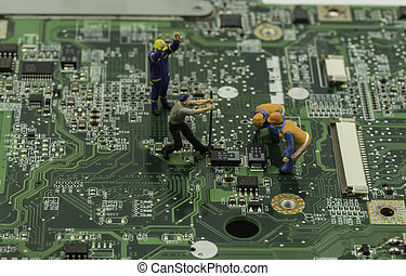 mini worker and technicial work on mainboard