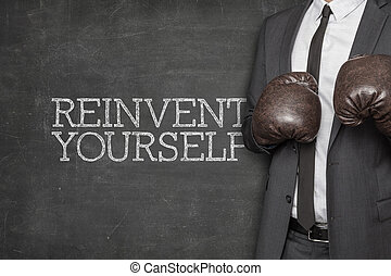Reinvent yourself on blackboard with businessman on side -...