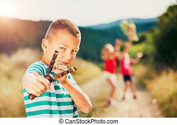 Boy with slingshot