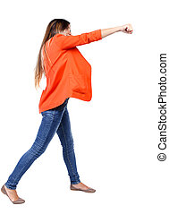 back view of woman funny fights waving his arms and legs...
