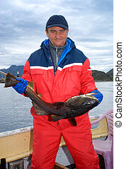 Fisherman with big cod - Fisherman with fish on the boat...