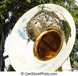 Navy Band reflected in tuba - A tuba with a reflection of a...
