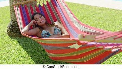 Single beautiful woman laying down in hammock - Single...