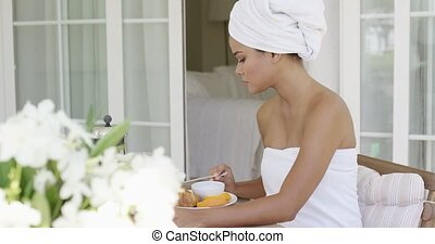 Gorgeous woman wrapped in towel sitting at table - Single...