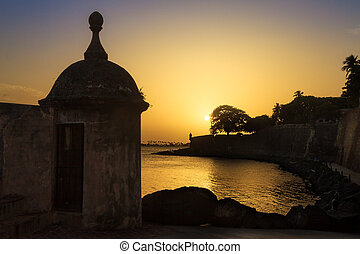Sentry wall silhouette - Beautiful summer sunset at the...