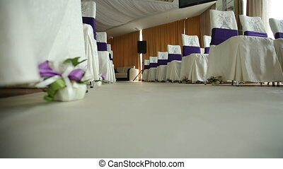 decoration flowers and chairs in wedding hall for the ceremony