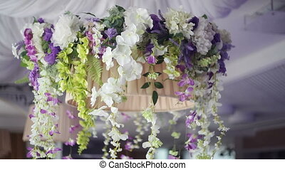 decoration of flowers in the restaurant for a wedding dinner