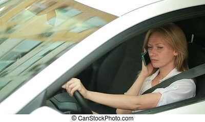 girl talking on the phone while sitting in the car - Young...