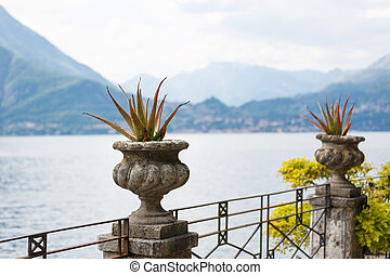 Shore of Lake Como in Varenna, Italy - Flower beds on the...