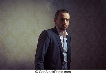 Young handsome man posing over vintage background