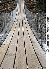 Suspension Bridge - Suspension bridge made of wooden planks...