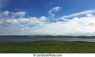 View at Harray Loch, Orkney on a sunny day - A View at...
