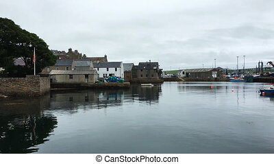 Pan of Stromness harbor in Orkney, Scotland - A Pan of...