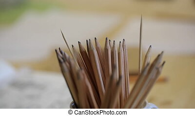 Close-up view of wooden pencils for drawing. Stationary is...