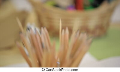 Close-up view of pot with pencils for drawing. Stationary is...