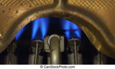 Geyser, water heater. The flame of a torch burns ,