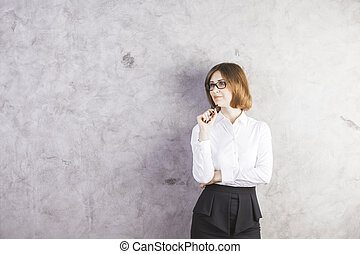 Smiling woman against concrete wall - Attractive smiling...