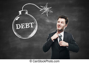 Debt concept with choking businessman and sketch on...