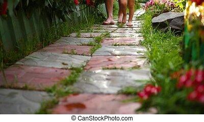 bare feet walking on a wet trail