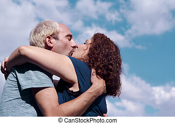 Couple in love kissingHappy couple - Man and woman kissing...