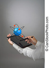 Man scientist holding a tablet PC with atom model, research...