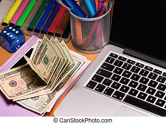 Money and electronic devices - Workplace with money and...