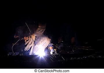 welder worker welding metal construction
