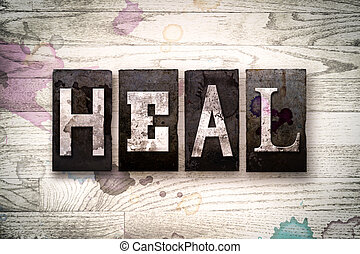 Heal Concept Metal Letterpress Type - The word HEAL written...
