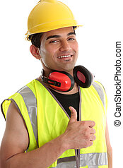 Smiling builder thumbs up - Smiling builder, construction...