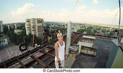 Extreme sports GoPro Camera Young man on the roof of...