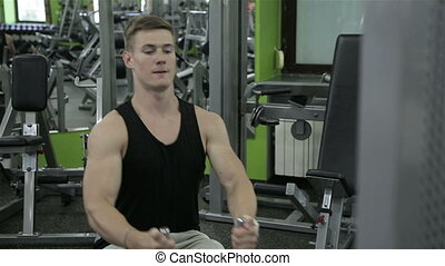 Close-up of a man performs gym exercises