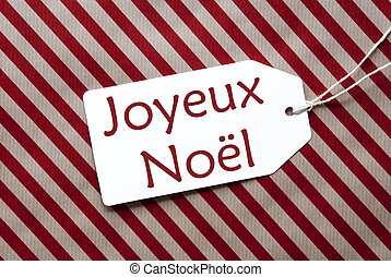 Label On Red Wrapping Paper, Joyeux Noel Means Merry...