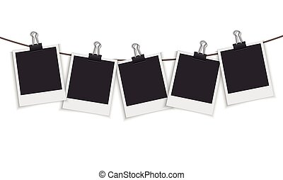 Blank photo frame hanging on a line with paper clip