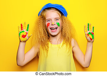 have fun with paints - Cute laughing little girl with...