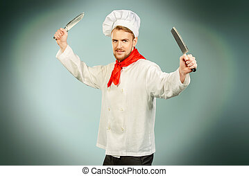 warlike cook - Portrait of a professional male cook holding...