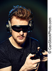 modern gamer - Passionate gamer with controller, headphones...