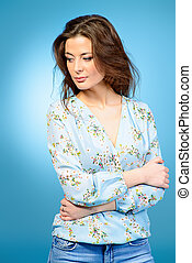 light blouse - Portrait of casual young woman over blue...