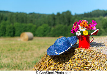 Bouquet flowers and summer hat in summer - Bouquet garden...