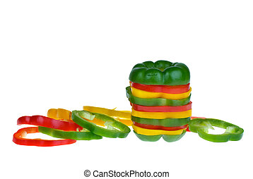 Red, yellow and green bell pepper slices isolated on the...
