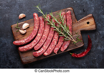 Sausages cooking - Sausages and ingredients cooking. Top...