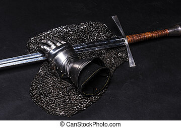 Armor and sword - Medieval chain mail, iron gauntlet and a...