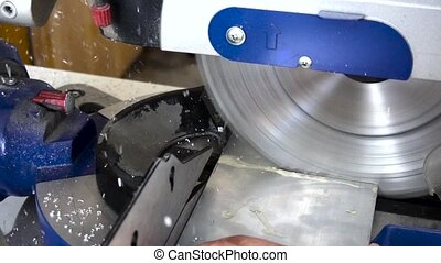 circular saw cutting metal slow motion