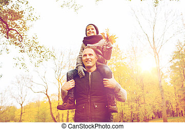 happy family having fun in autumn park - family, childhood,...