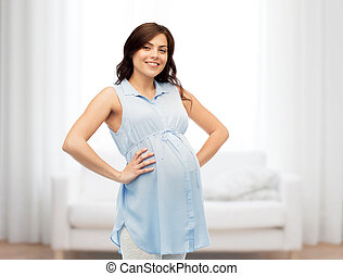 happy pregnant woman touching her big belly - pregnancy,...