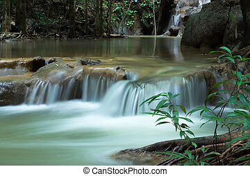 Small waterfall in the forest in summer. - Small waterfall...