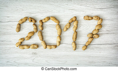 PF 2017 made from the peanuts. Happy New Year. Symbolic...