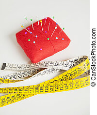 Pincushion And Measure Tape On Table At Factory - High angle...