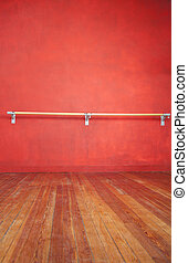 Ballet Bar Against Wall In Studio - Ballet bar against red...